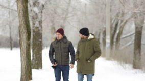 Two friends are going in winter park stock footage