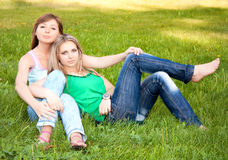 Two friends on grass Royalty Free Stock Photo