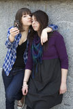 Two friends having a blast with a phone. Stock Images