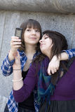 Two friends having a blast with a phone Royalty Free Stock Photos