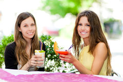 Two friends having a cocktail outdoor Royalty Free Stock Photography