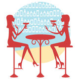 Friends having a drink. Two friends having a drink and talking Royalty Free Stock Image