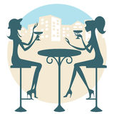 Friends having a drink. Two friends having a drink and talking Stock Photography