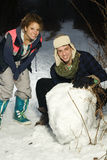 Two friends having fun in snow Stock Photo