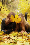 Two friends hide face Stock Photography