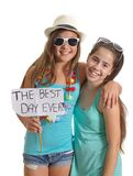 Two friends holding a Best Day Ever sign Royalty Free Stock Image