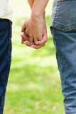 Two friends holding hands Stock Image