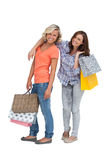 Two friends holding shopping bags Royalty Free Stock Photography