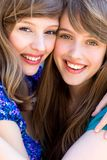 Two friends hugging Stock Image
