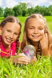 Two friends with jar and butterfly Stock Photography