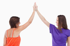 Two friends joining their hands in the air Royalty Free Stock Photo