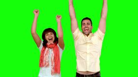 Two friends jumping on green screen. In slow motion stock video footage