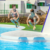 Two  friends jumping in the pool Stock Photos