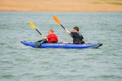 Two friends on the kayak boat royalty free stock photo