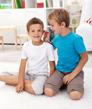 Two friends in the kids room. Talking secrets and having fun Stock Image