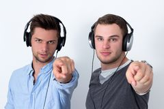 Two friends listening to music Stock Photo