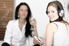 Two friends listening to music Stock Images
