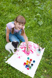 Two friends-  little  girl and puppy Stock Images