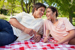 Two friends looking at each other while having a picnic Royalty Free Stock Images