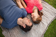 Two friends looking at each other while lying on a quilt Royalty Free Stock Photography