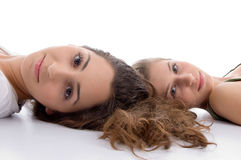 Two friends lying and looking at camera Royalty Free Stock Photo