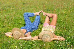 Two friends lying together in meadow Stock Photography