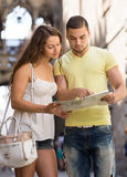 Two friends with map in the street Stock Photos