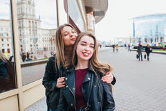 Two friends meeting in the street of the city and hugging . friendship, happiness concept . Couple of women on the street Stock Photography