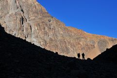 Two friends in the mountains. Morocco, High Atlas mountains in winter Royalty Free Stock Photography
