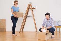 Two friends moving together in a new house Royalty Free Stock Photos
