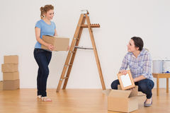 Two friends moving together in a new house Royalty Free Stock Photo