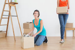 Two friends moving together in a new house Stock Photography