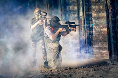 Two friends in paintball. Club during game Royalty Free Stock Photography