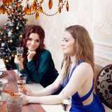 Two friends on a party, girl sitting at the Stock Image