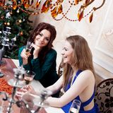 Two friends on a party, girl sitting at the Royalty Free Stock Photos