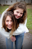 Two Friends Piggyback royalty free stock photo