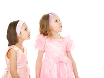 Two friends in a pink dress looking up Stock Photos