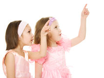 Two friends in a pink dress looking up Stock Images