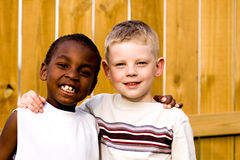 Two friends playing outside. Here are two friends smiling at the camera Stock Photos