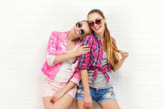 Two friends posing. modern lifestyle. two stylish hipster girls best friends ready for party. Two young girl royalty free stock image