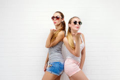 Two friends posing. modern lifestyle. two stylish hipster girls best friends ready for party. Two young girl royalty free stock images