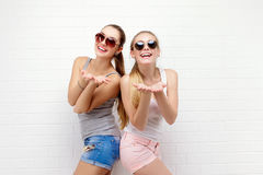 Two friends posing. modern lifestyle. two stylish sexy hipster girls best friends ready for party. Two young girl Stock Photos