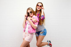 Two friends posing. modern lifestyle.two stylish hipster girls best friends ready for party. Young girl friends royalty free stock images
