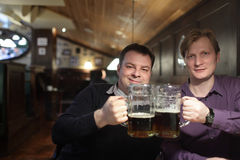 Two friends in a pub Royalty Free Stock Image