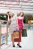 Two friends with purchases Royalty Free Stock Images