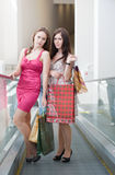 Two friends with purchases Royalty Free Stock Photos