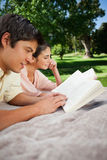 Two friends reading books in a park Royalty Free Stock Image