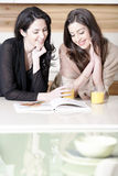 Two friends reading recipes Stock Image