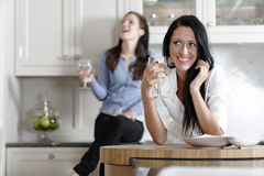 Two friends relaxing in the kitchen Royalty Free Stock Images