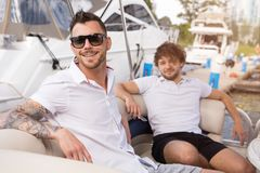 Two young guys are resting on yacht stock image